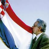 The First President of the Republic of Croatia, the late Dr Franjo Tuđman, kissing the new Croatian flag
