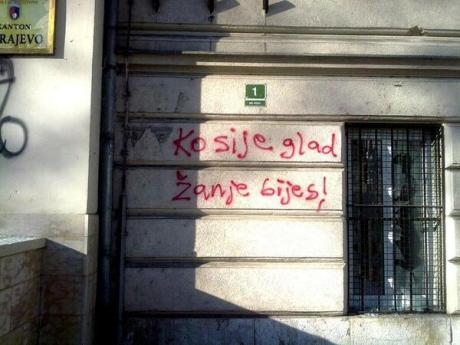 "Graffiti: ""He who sows hunger, reaps anger!"""
