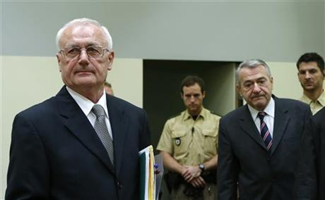 Defendants Josip Perkovic , left,  and Zdravko Mustac, second right,  former members of the Yugoslav secret service,  arrive for their trial in a Munich courtroom  Friday Oct. 17, 2014. A former head of Yugoslavia's  secret service and a one-time subordinate  have gone on trial in Germany  over the 1983 killing of a Croatian national in Bavaria.  Zdravko Mustac and former subordinate Josip Perkovic,  who later created independent Croatia's spy agency,  are both charged with being accessories  to the murder of Stjepan Djurekovic.  The dissident was shot and beaten on July 28, 1983  in a garage in Wolfratshausen, near Munich.  (AP Photo//Michaela Rehle,Pool)