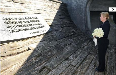 Croatia's President Kolinda Grabar-Kitarovic bows to the victims at Jasenovac