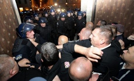 Croatian war veterans seek refuge inside church from police brutality Photo: Zeljko Lukunic/Pixsell