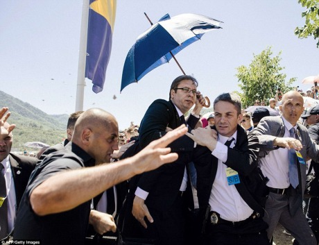 Serbia's Prime Minister Aleksandar Vucic (Centre) Whisked Away From Srebrenica, Bosnia, Mourning Graveyard Amidst Pelting Of Stones And Bottles Against Him Saturday 11 July 2015 Photo: AFP/Getty Images
