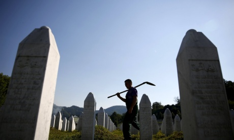 Worker tending to Srebrenica memorial graveyard  Photo: Dado Ruvic/Reuters