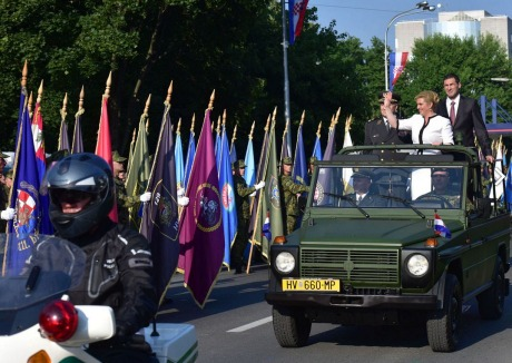 President Kolinda Grabar Kitarovic greets the military parade participants from army vehicle 4th August 2015 Photo: Pixsell