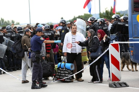 Assisting refugees onto buses in Croatia Saturday 19 September 2015