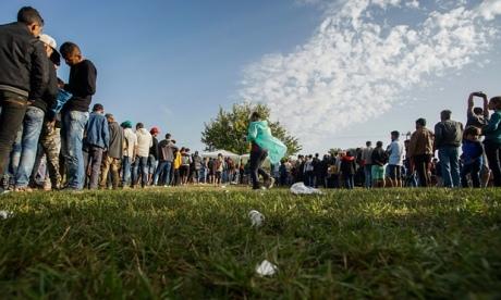 Refugees in Tovarnik, Croatia waiting in line for food