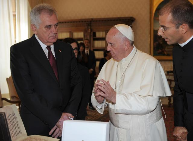 Pope Francis speaks with Serbian President Tomislav Nikolic, during a private audience at the Vatican, Friday, Sept. 11, 2015. (Claudio Onorati/Pool photo via AP)