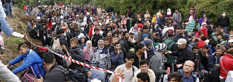 Refugees enter Croatia at the Serbia-Croatia border Croatian President Wants to Close these illegal border crossings and keep official ones open The Government opposes this Photo: EPA/Antonio Bat