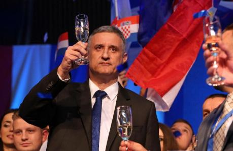 Leader of Croatian Democratic Union/HDZ Tomislav Karamarko raises a glass to relative victory at 2015 general elections in Croatia Victory not enough to form government Photo: AFP