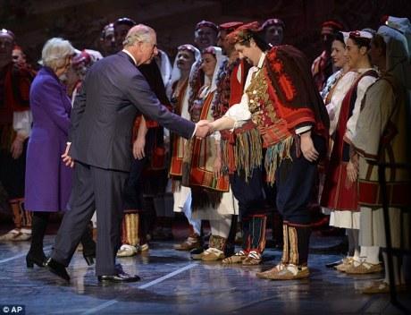 Prince Charles with Croatian folklore dancers Photo: Tim Rooke/REX/Shuttlestock