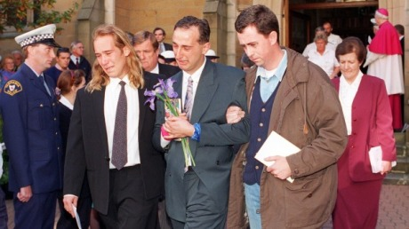 Walter Mikac (centre) with family and friends at Memorial service after Port Arthur massacre Photo: Rick Stevens
