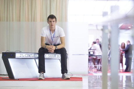 Croatia's innovator Ivan Mrvos sitting on his Smart Bench