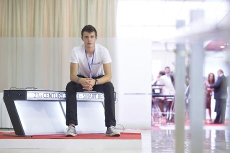 Croatia's innovator Ivan Mrvos sitting on his Smart Bench