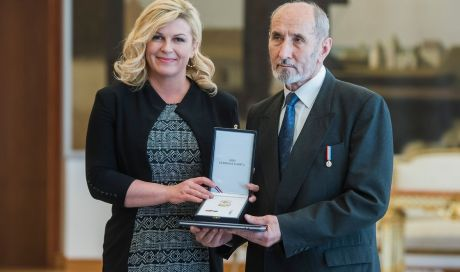 Croatian president Kolinda Grabar-Kitarovic with Nikola Stedul survivor of 1988 assassination attempt in Scotland by Yuogoslav communist secret police Photo:Neja Markicevic/Cropix