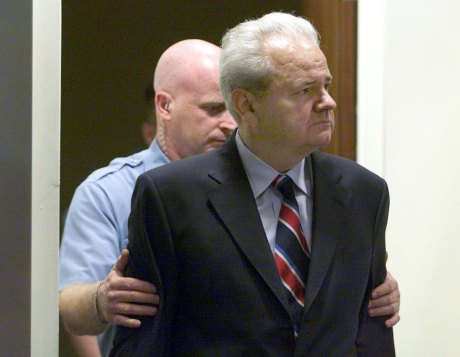 Former Serbian president Slobodan Milosevic is led into the courtroom of the UN War Crimes Tribunal in The Hague 2002 PHOTO : JERRY LAMPEN/AFP/Getty Images