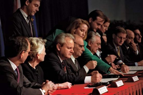 OHIO, Nov. 21, 1995 from Centre left: President Slobodan Milosevic of the Federal Republic of Yugoslavia, President Alija Izetbegovic of the Republic of Bosnia-Herzegovina, and President Franjo Tudjman of the Republic of Croatia sign the Dayton Peace Accords. Photo: U.S. Air Force/Staff Sgt. Brian Schlumbohm