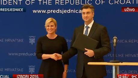 President Kolinda Grabar-Kitarovic hands new prime minister mandate to Andrej PLenkovic Croatia 10 October 2016 Photo: office of president of Croatia