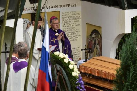 Bishop Lipovsek blessing the caskets with victims' remains Monday 3 October 2016 Huda Pit Slovenia Photo: STA