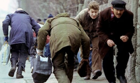 Civilians of Sarajevo in Bosnia and Herzegovina 1993 running for cover to avoid Serb snipers during the city's siege Photo: Chris Helgren/Corbis