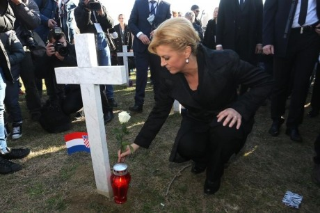 President Kolinda Grabar-Kitarovic lights candles at Vukovar Memorial Cemetery 18 November 2016 Photo: Marko Markonjic/Pixsell