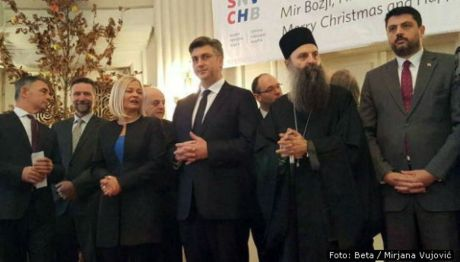 Serb Orthodox Christmas reception in Zagreb Croatia 5 January 2017 Vladimir Bozovic (R) representing Serbia's PM Andrej Plenkovic (C) Croatian Prime Minister Milorad Pupovac (L) head of Serb National Council in Croatia and MP